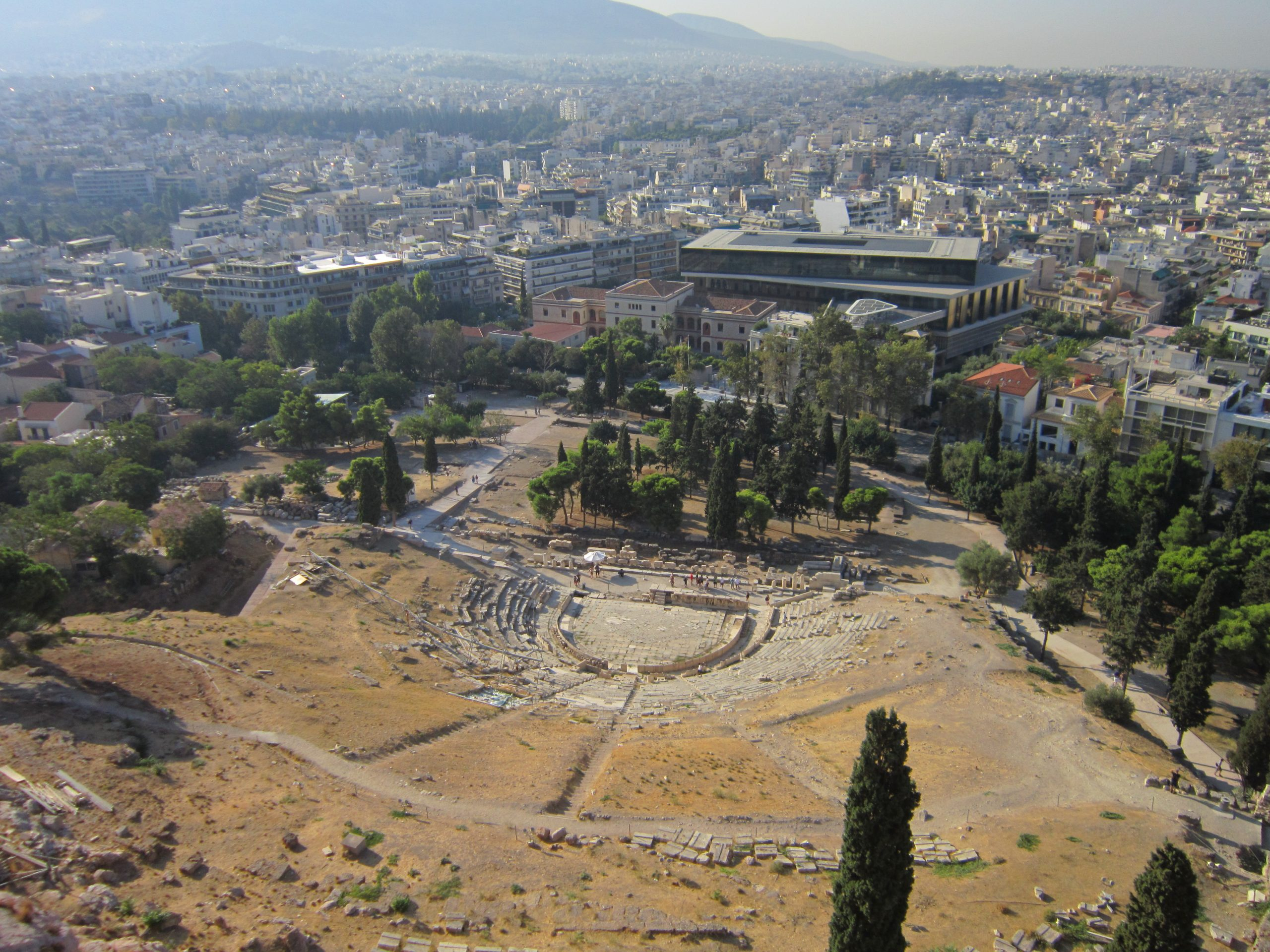 Looking over the top of  The Theatre of Dionysus with the city spread out beyond.