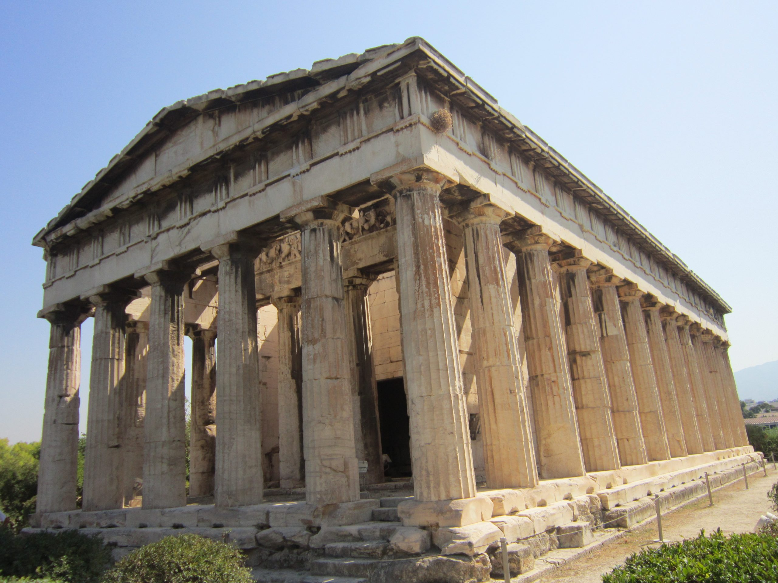 Temple of Hephaestus, showing how it is a long building with many pillars holding up a roof.
