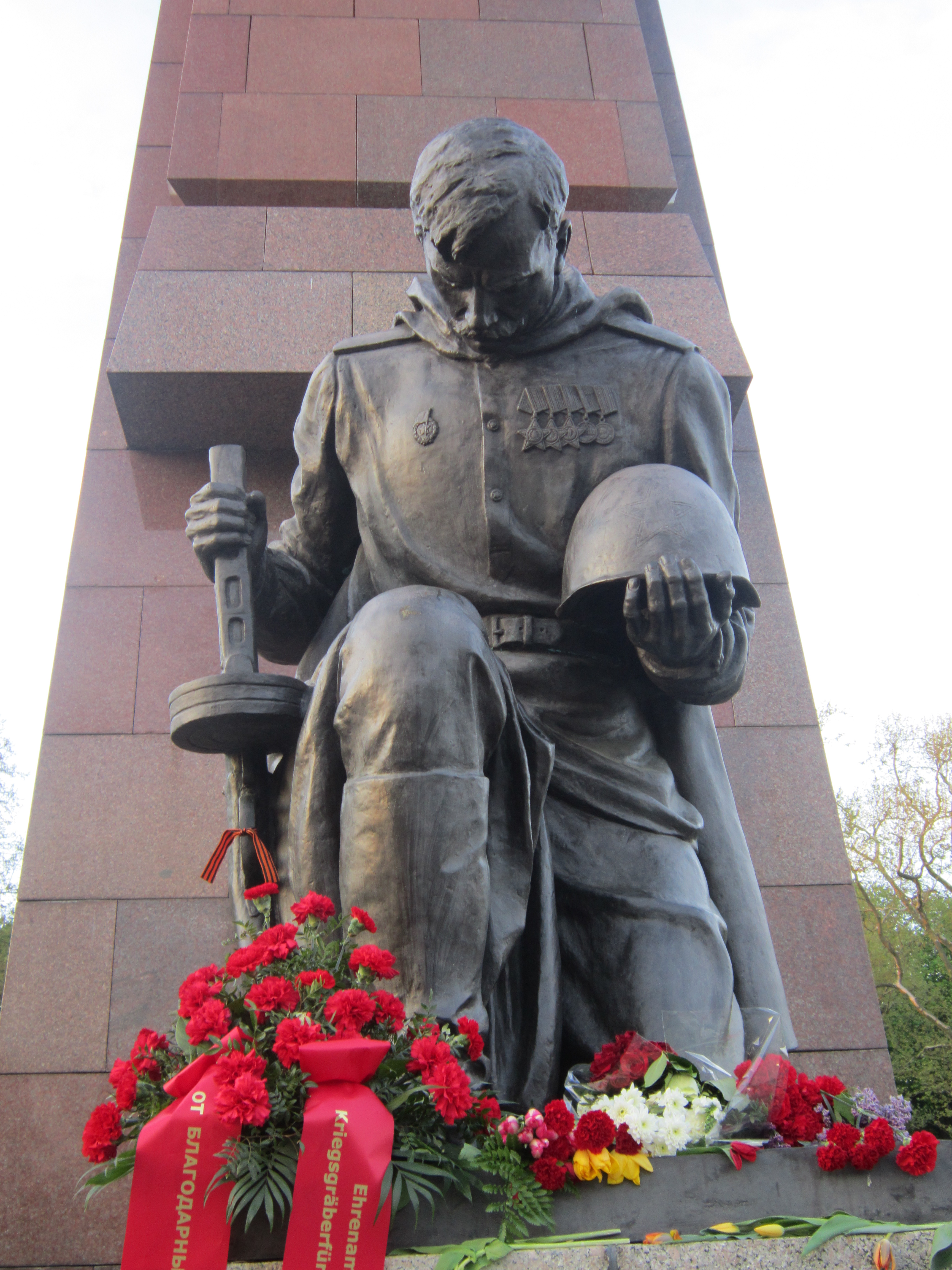 things to do in Berlin - statue of a soviet soldier at the The Soviet War Memorial in Treptower Park