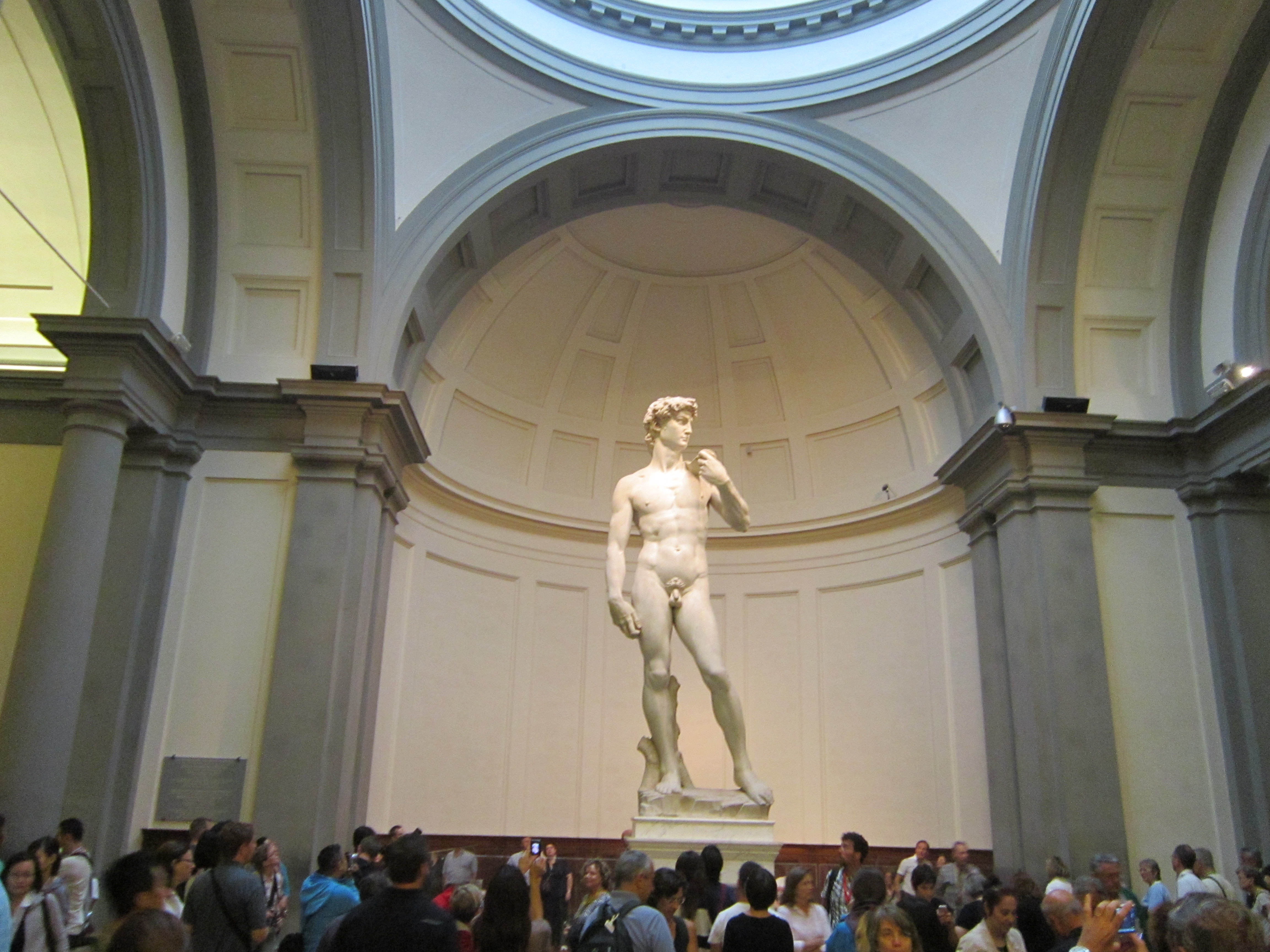 The David statue, with people all around it's bottom looking up at it
