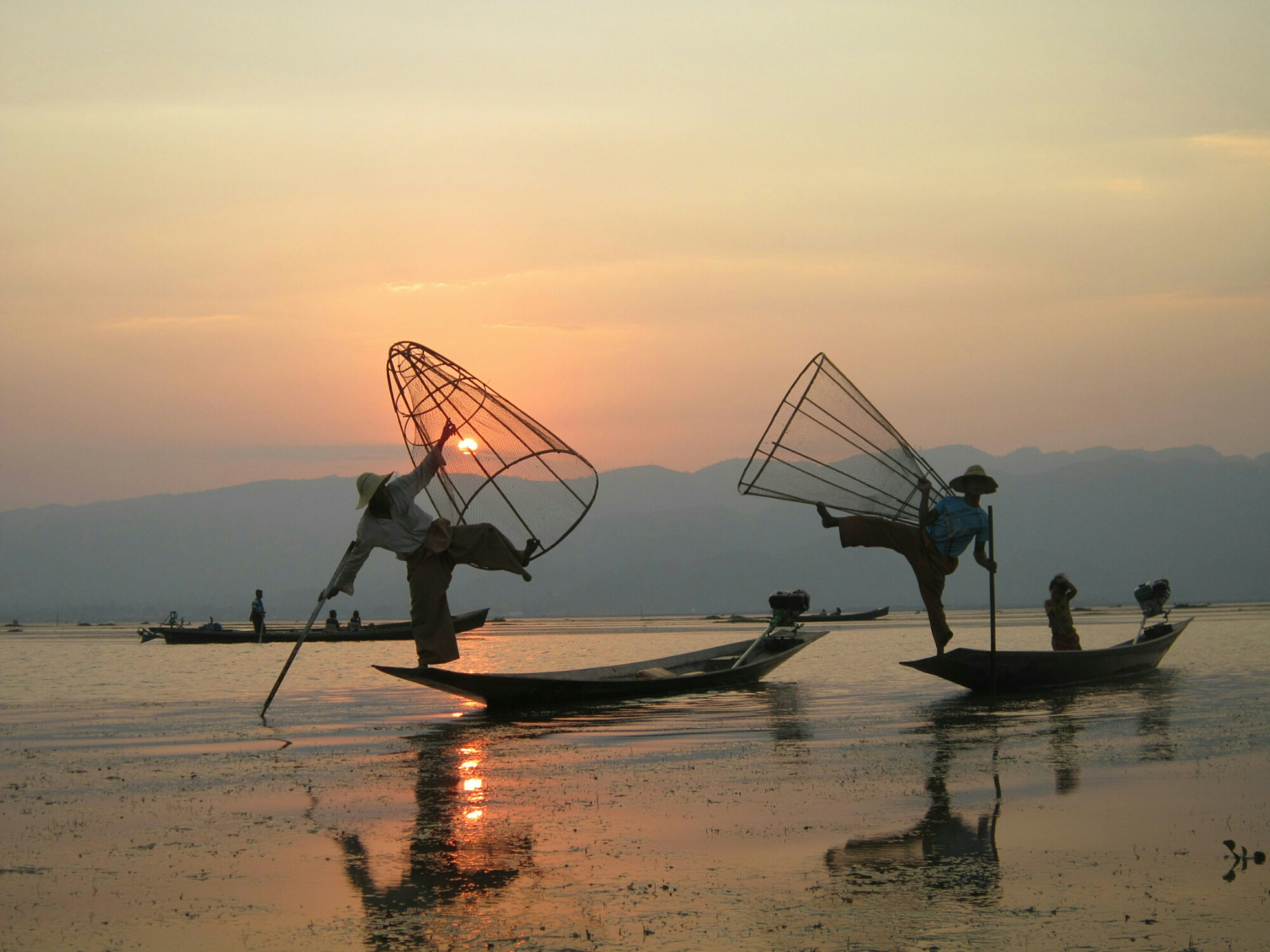 Fisherman pose at sunset on Inle Lake, Myanmar