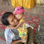 Burmese father and child visiting Botataung Paya, the people on Myanmar