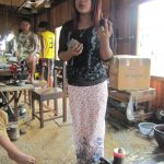 The People Of Myanmar - Shop worker on Inle Lake