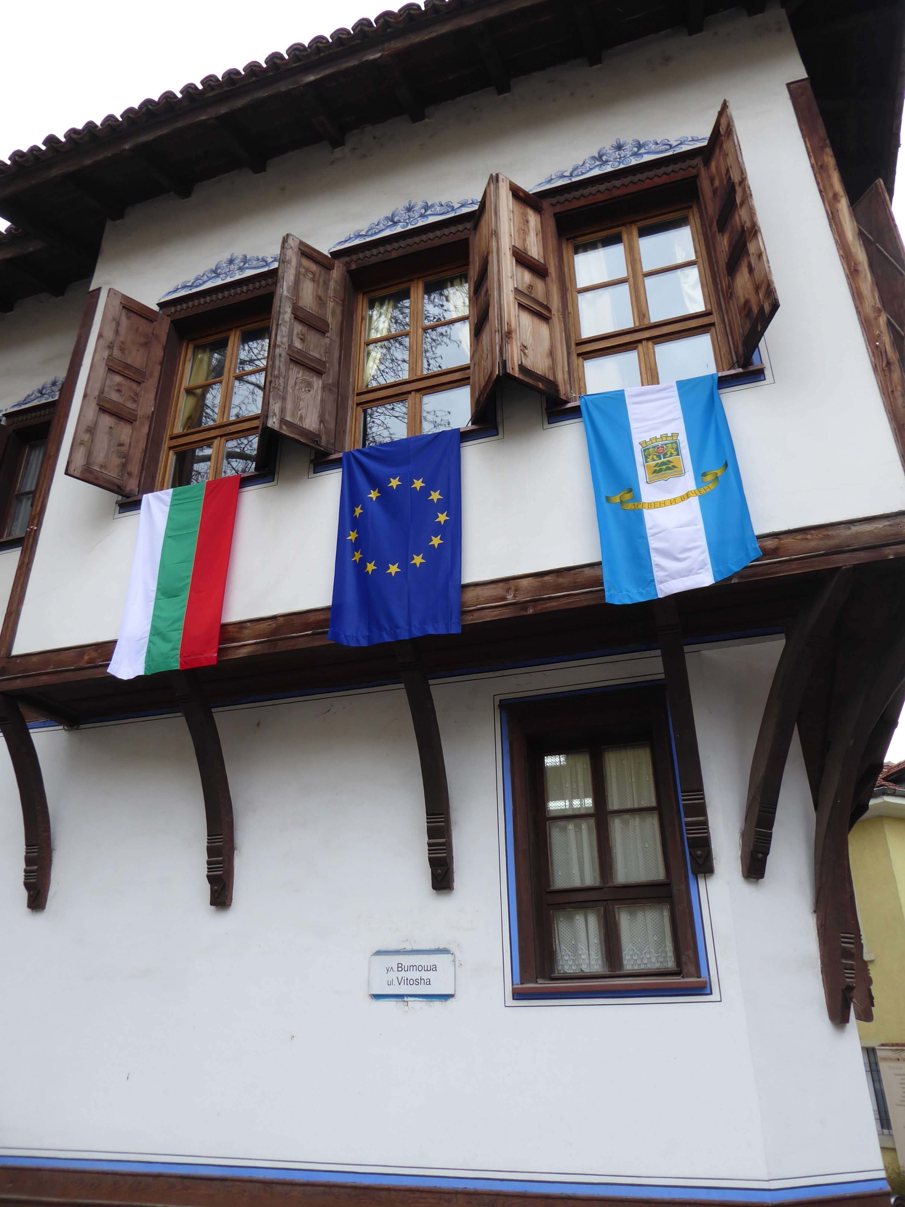 Building in the Old Town in Plovdiv. Flying 3 flags inc EU and Bulgaria and Local