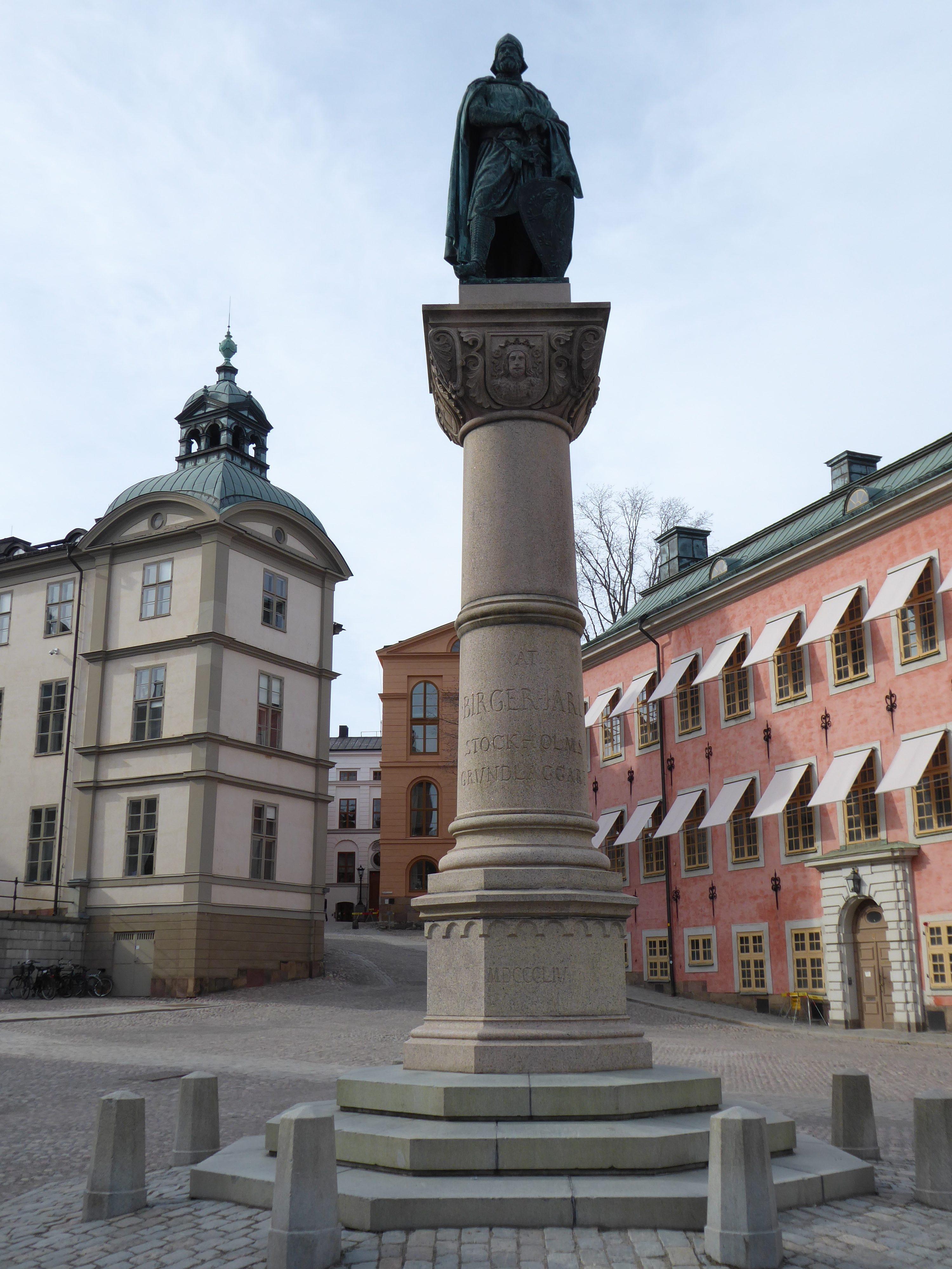 Central statue of Birger Jarl, in backgroundred building on ight, white building on left on Riddarholmen island, Stockholm