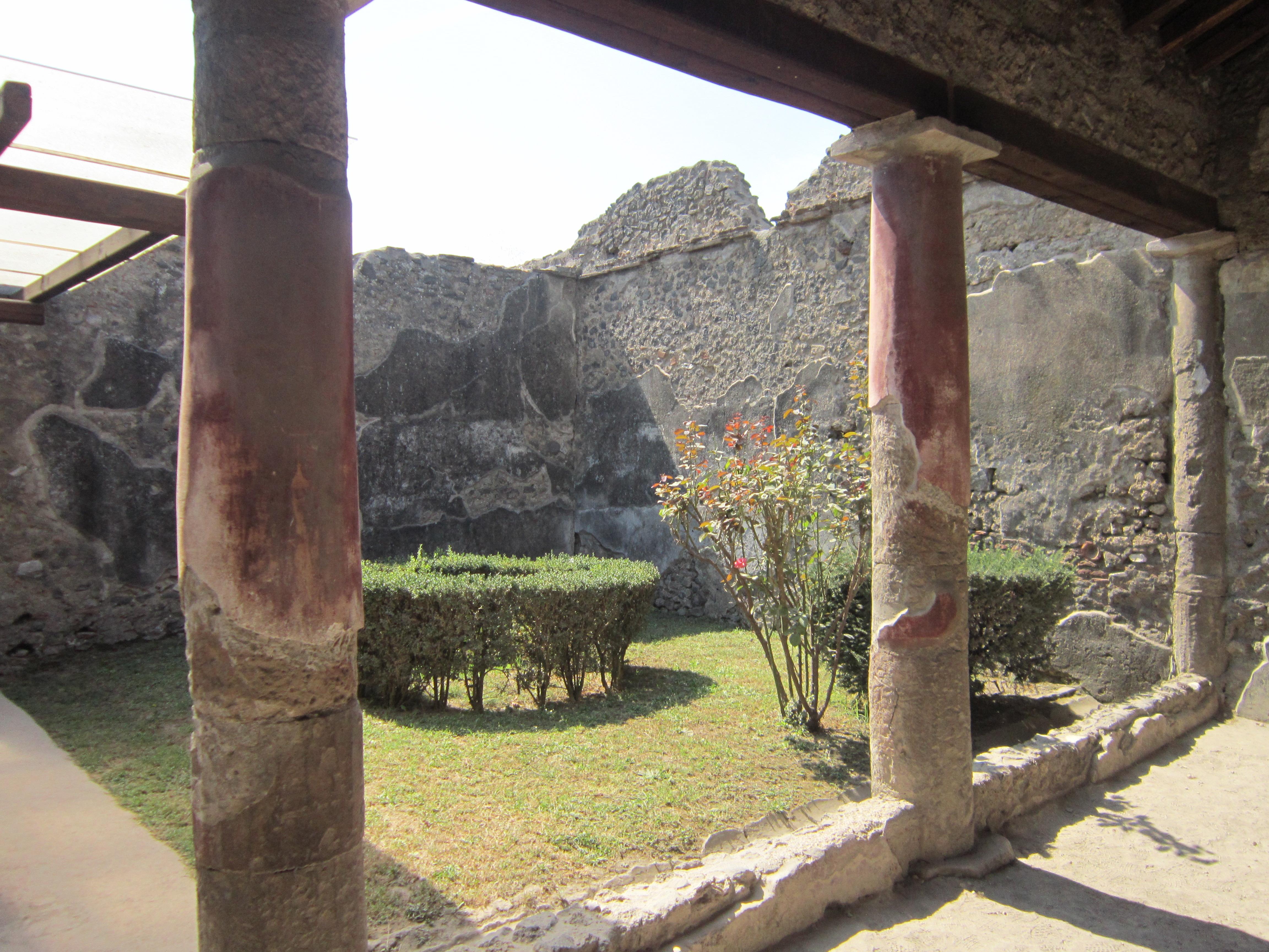 Inside a ruined building Pompeii that has an inner courtyard garden