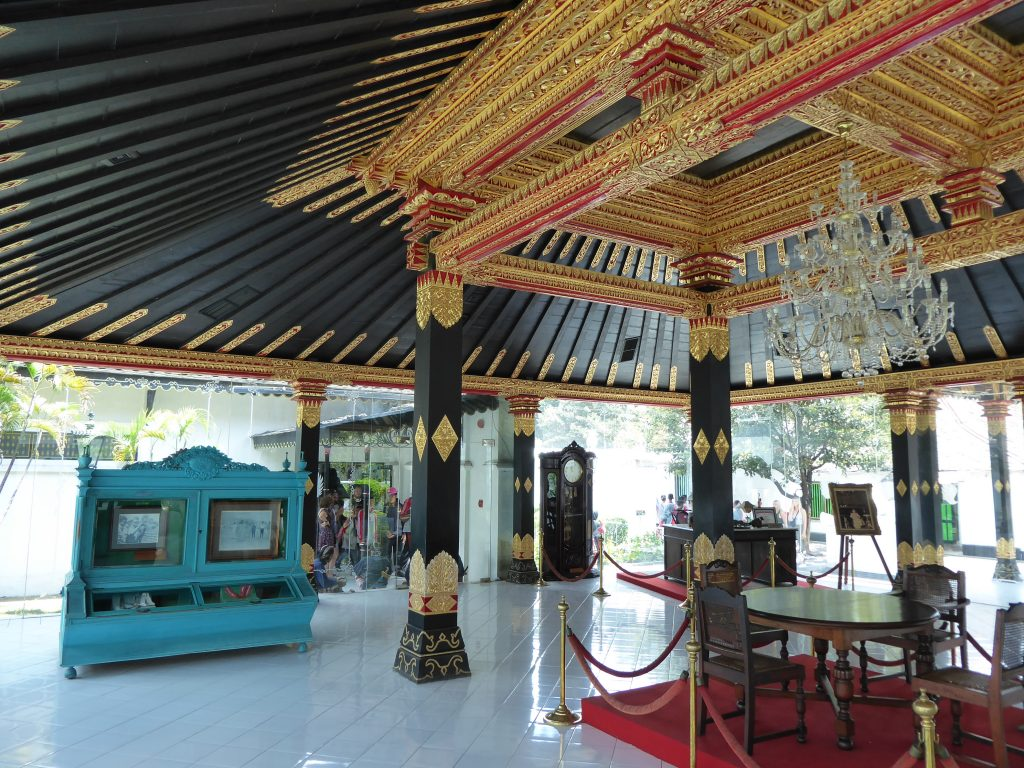 Yogyakarta Travel Guide - Explore inside the Sultan's palace - room with black and gold roof and furniture
