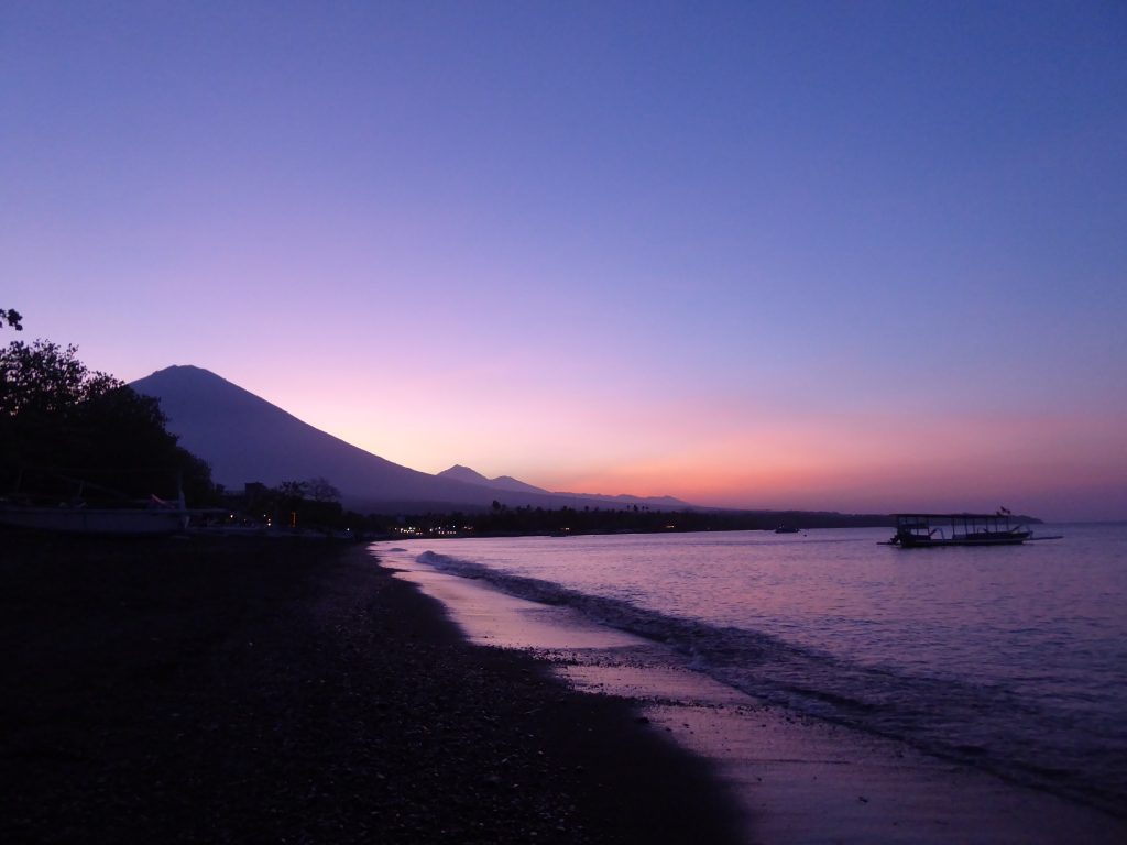 View of Mount Agung from Amed beach at sunset