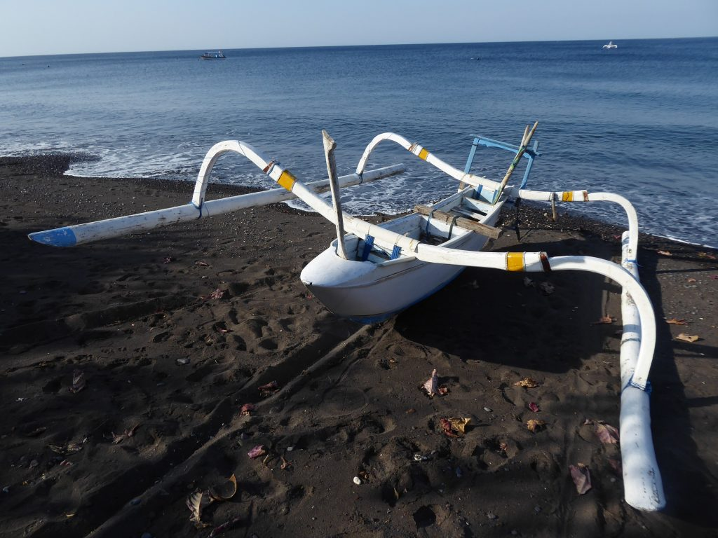 A boat parked up on the beach at Amed