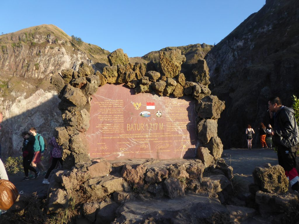A plaque marking the summit height on Mount Batur