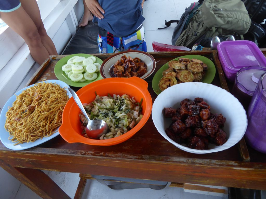 Komodo Islands Travel guide - One of the meals prepared on the Komodo boat tour - tofu, fish, noodles, salad, fried eggplant all in bowls