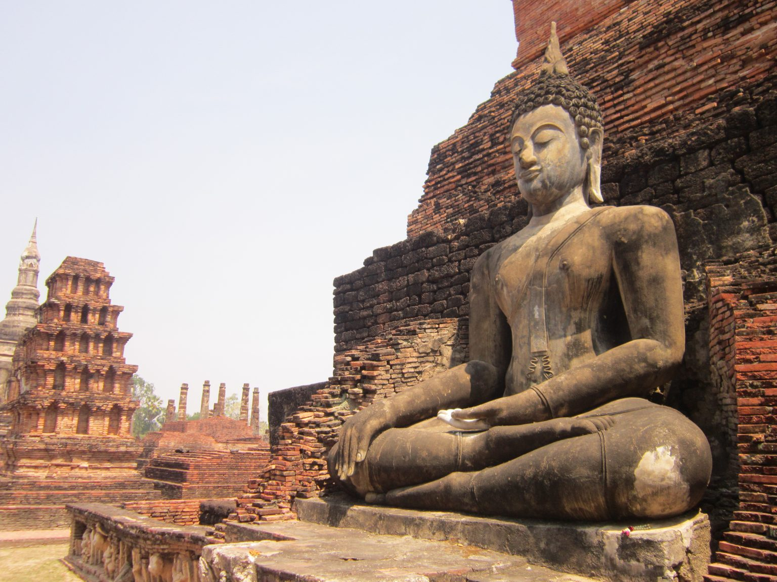 Sitting Buddha statue in Sukhothai Historical Park - North Thailand Itinerary