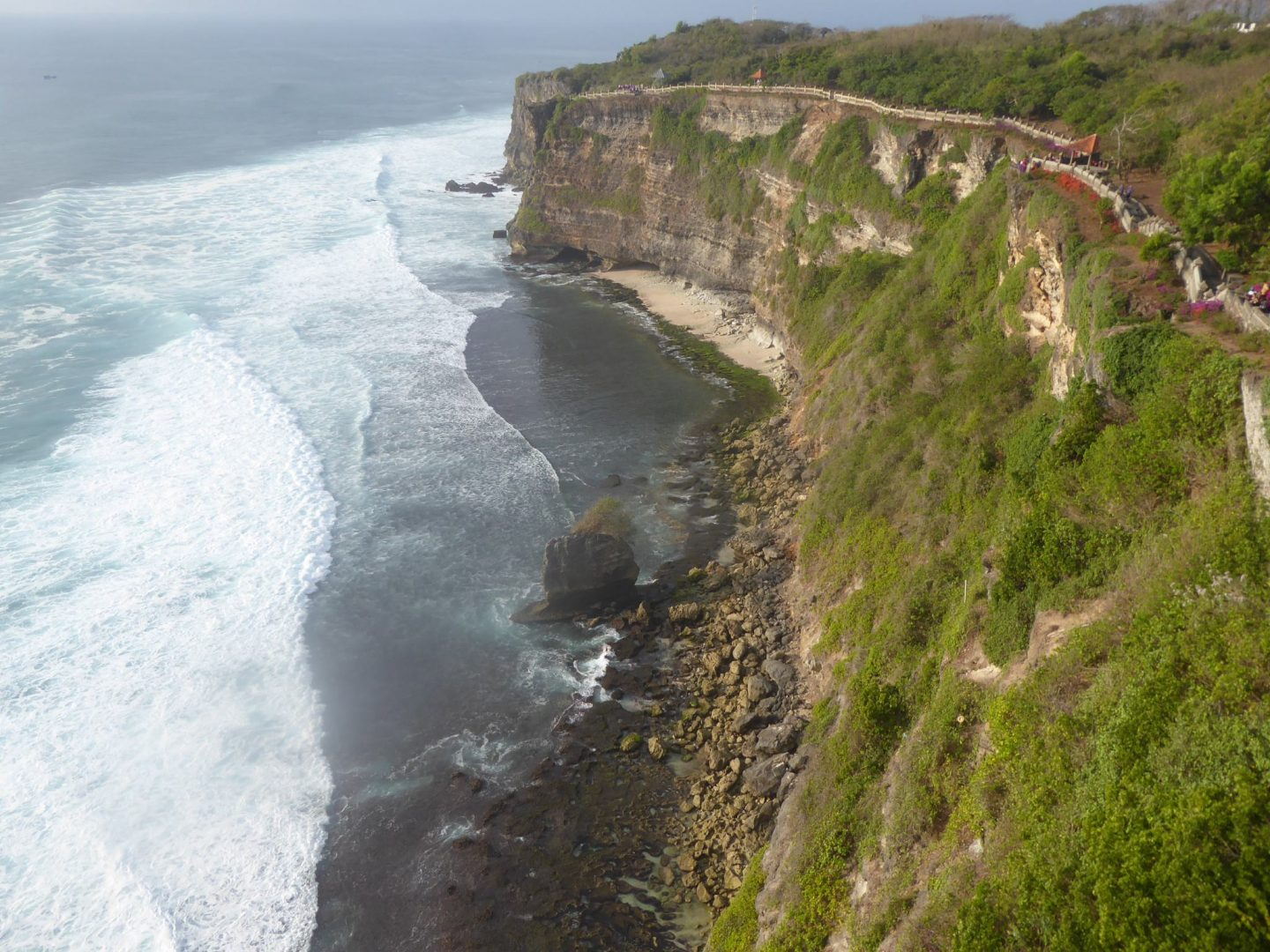 Looking over the cliff edge at the Uluwatu Temple  - 8 Must See Balinese Temples