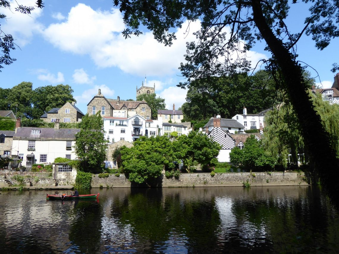 View across the river of buildings in Knaresborough.