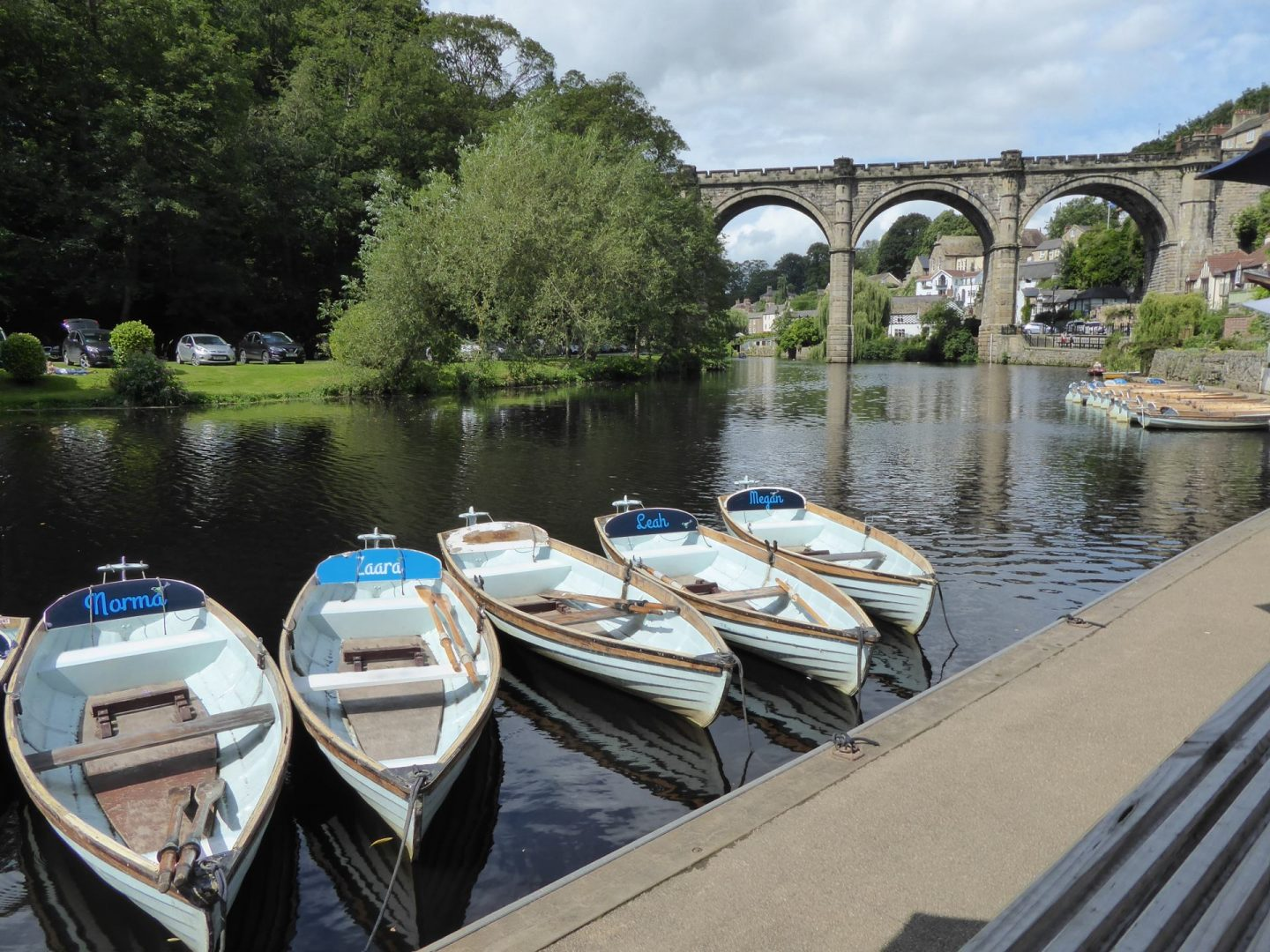 View of River Nidd from Marigolds Cafe - docked boats in the foreground,