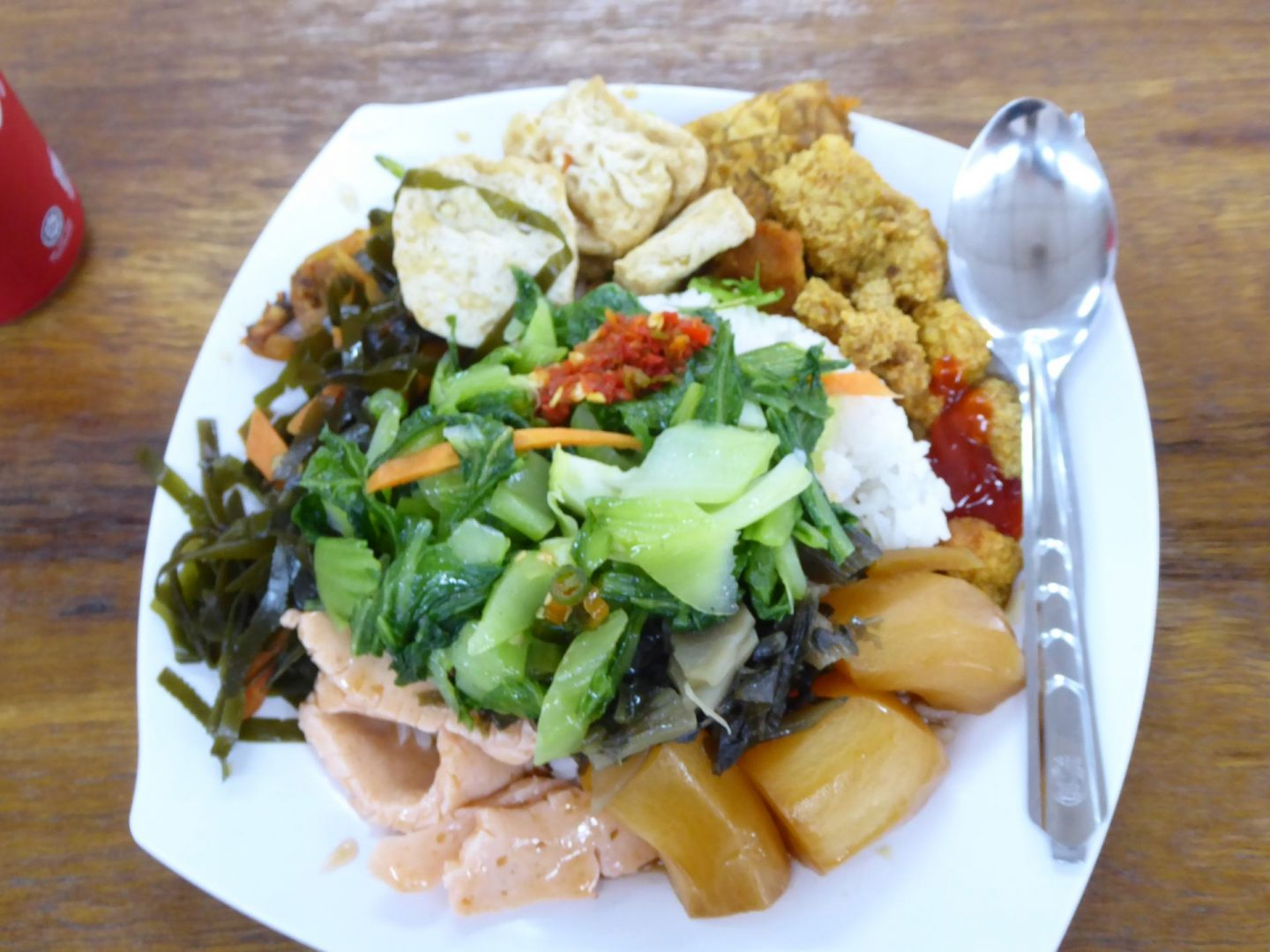 A plate of Chinese Malaysia Vegetarian Food including vegetables and 'mock meat' made from soy and other vegetable protein