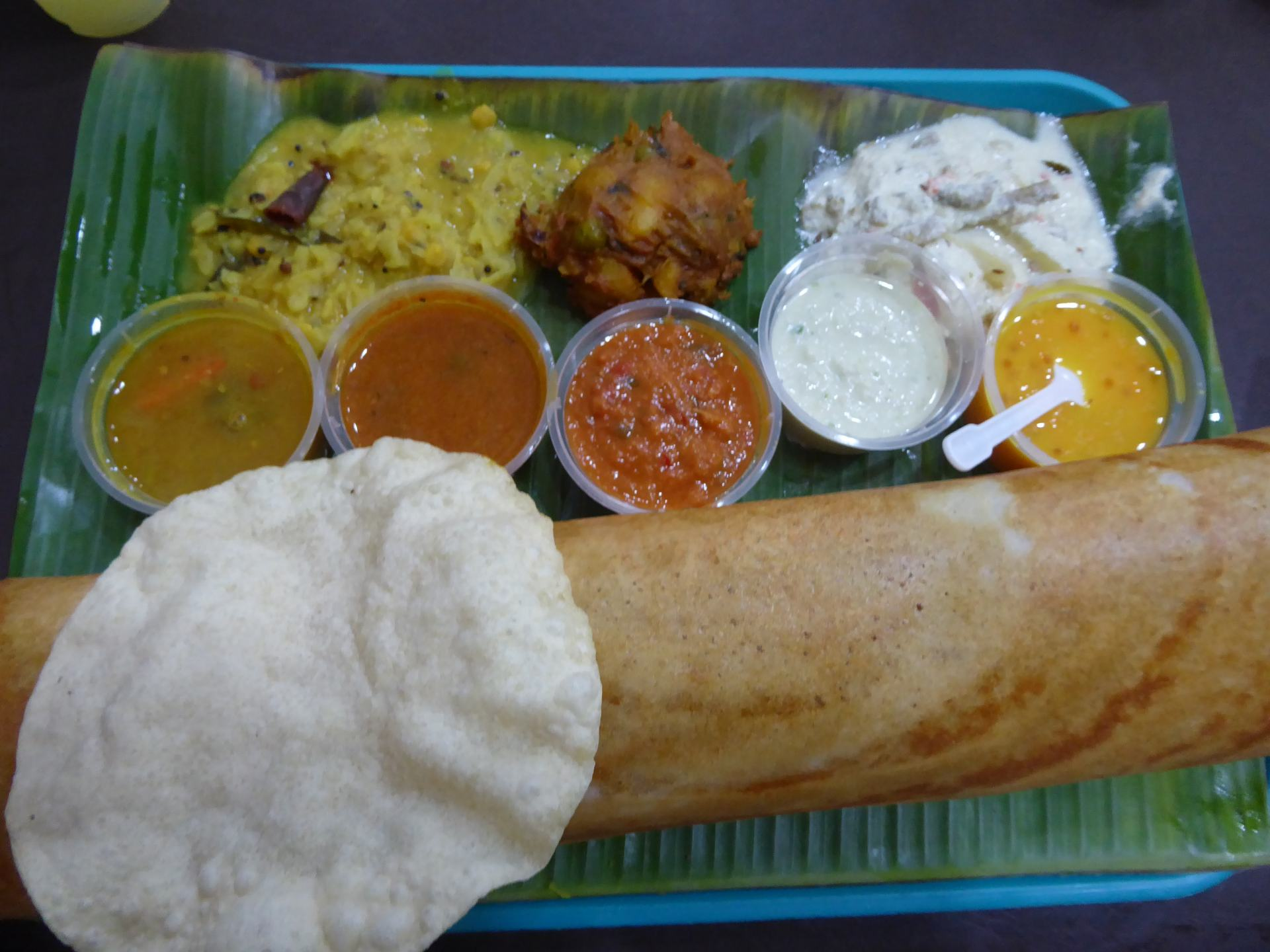 Indian Food in Singapore. Dosa, poppadom and several curry's on banana leaf