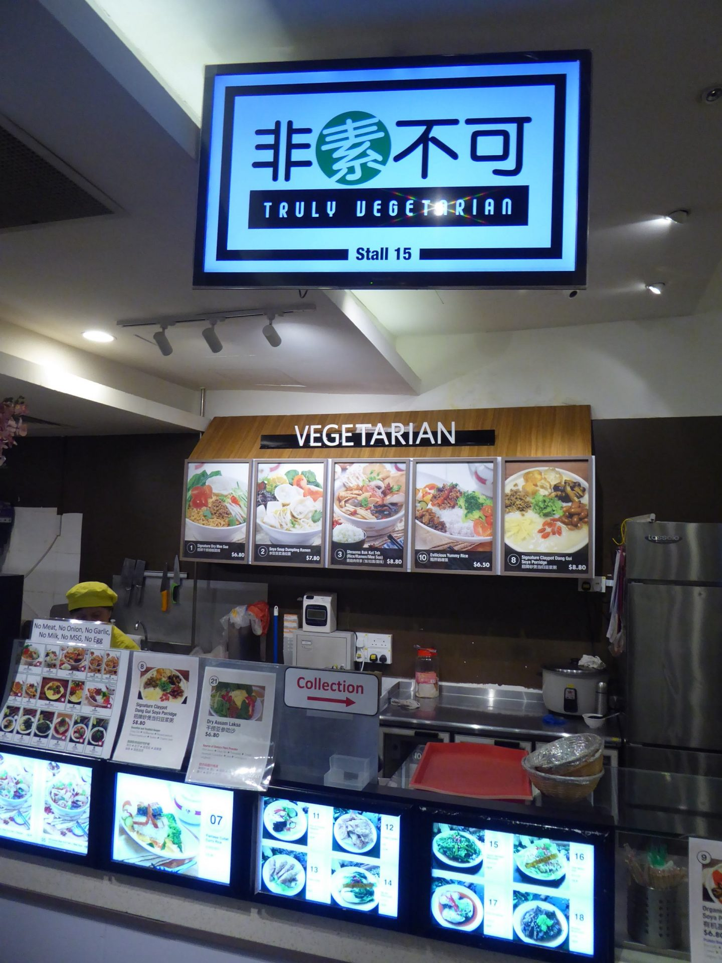 The Truly Vegetarian 非素不可  stall. It has several pictures of food that can be ordered.