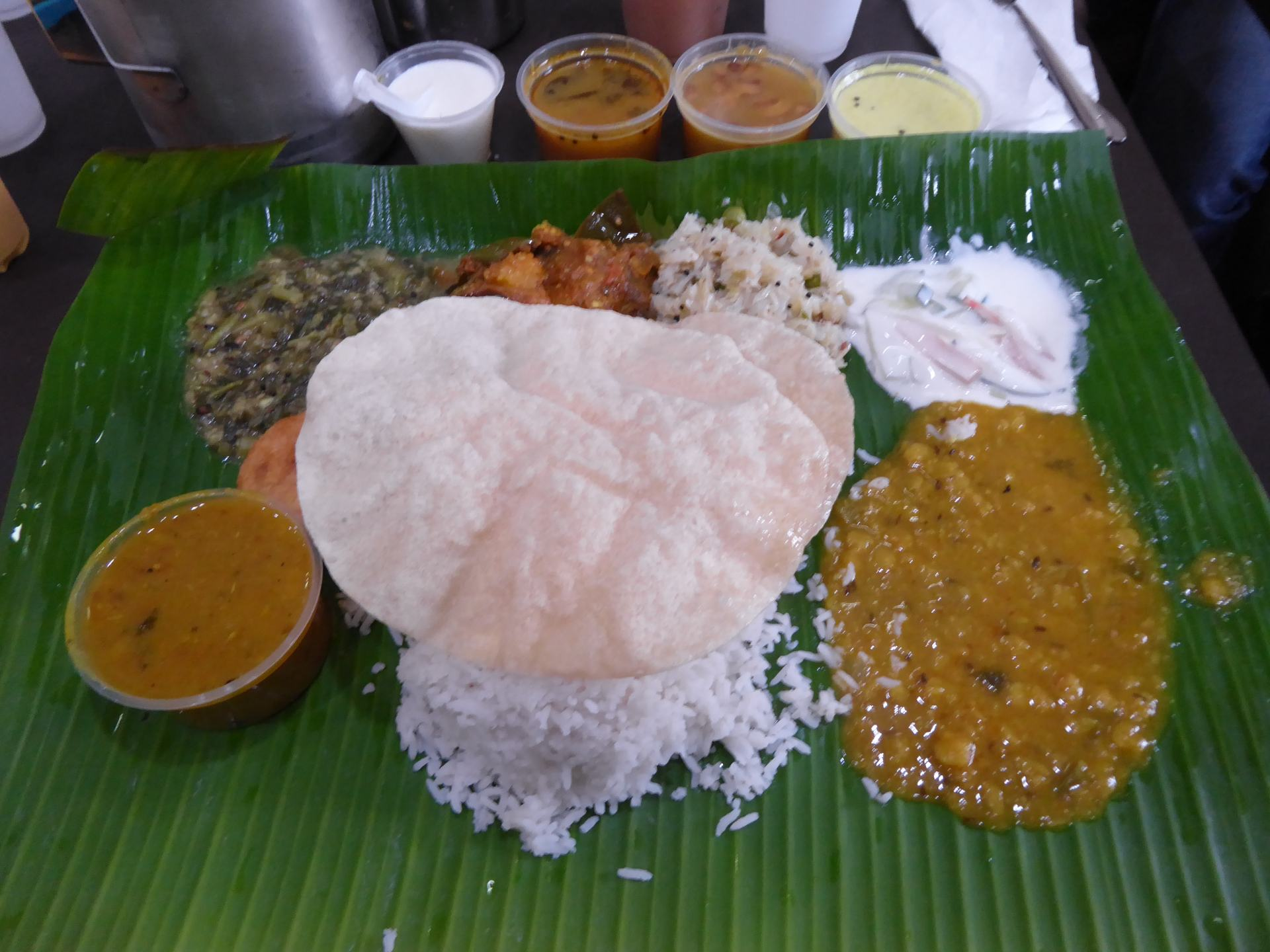 An example of Singapore Vegetarian Food - a rice meal at Komala Vilas on Serangoon Road. Including several curry and dips in pots as well as poppadoms