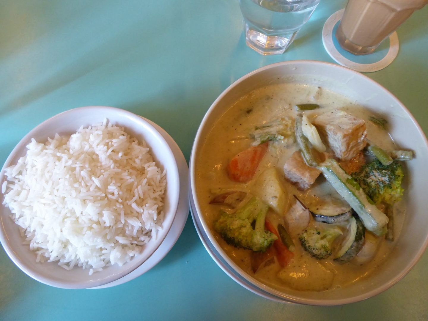 Vegetarian Green Thai Green Curry is one bowl, rice in the other.