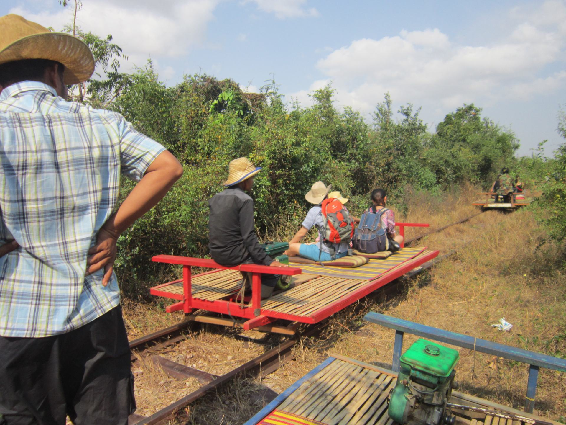 People riding the Bamboo train, one of the recommended activities on this Cambodia Itinerary.