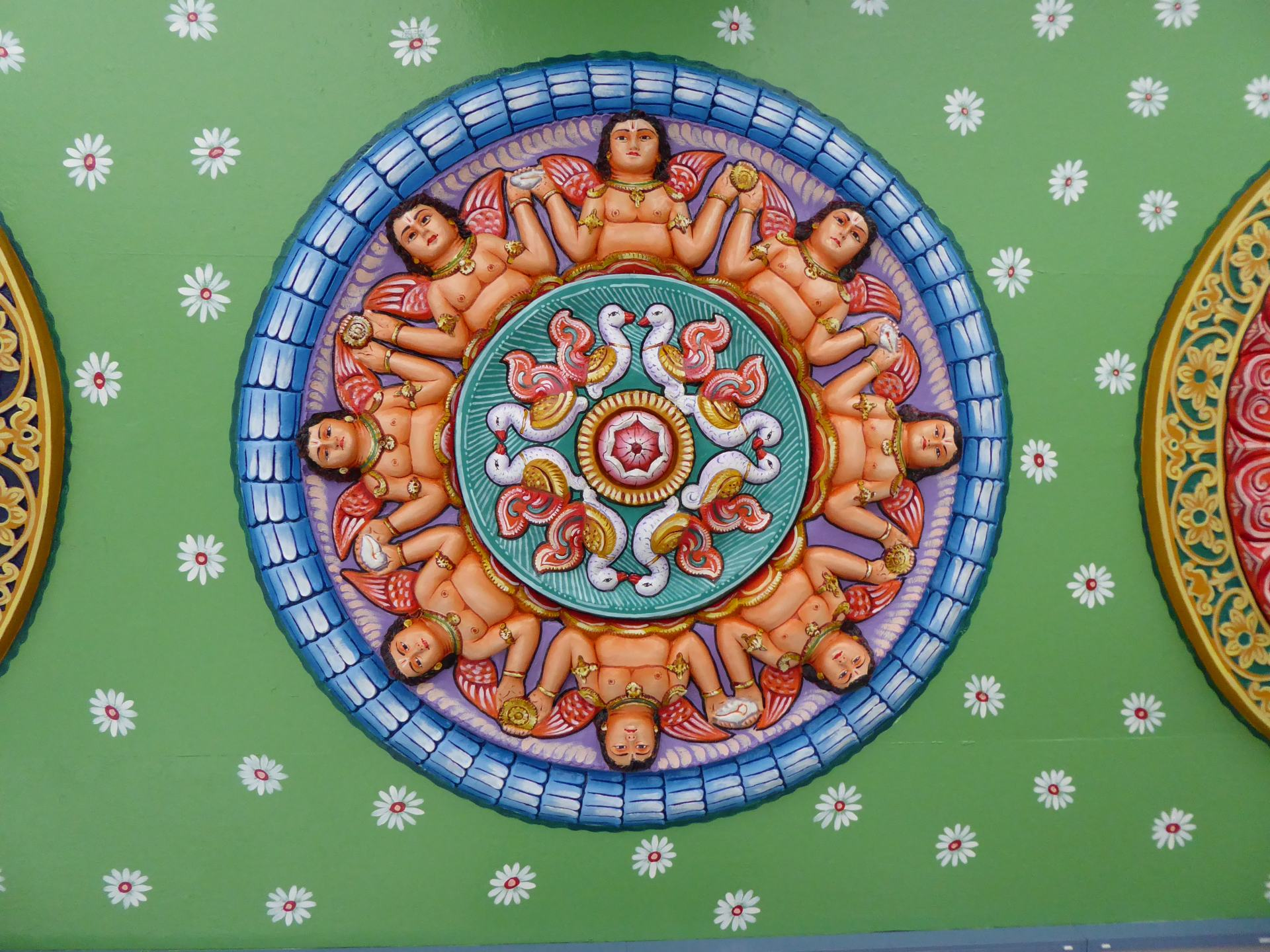 A round Hindu colourful image on the ceiling at Sri Srinivasa Perumal Temple.