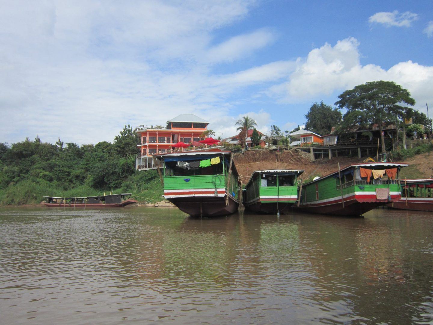 A views of slow boats docked in Huay Xai, taken looking back at shore