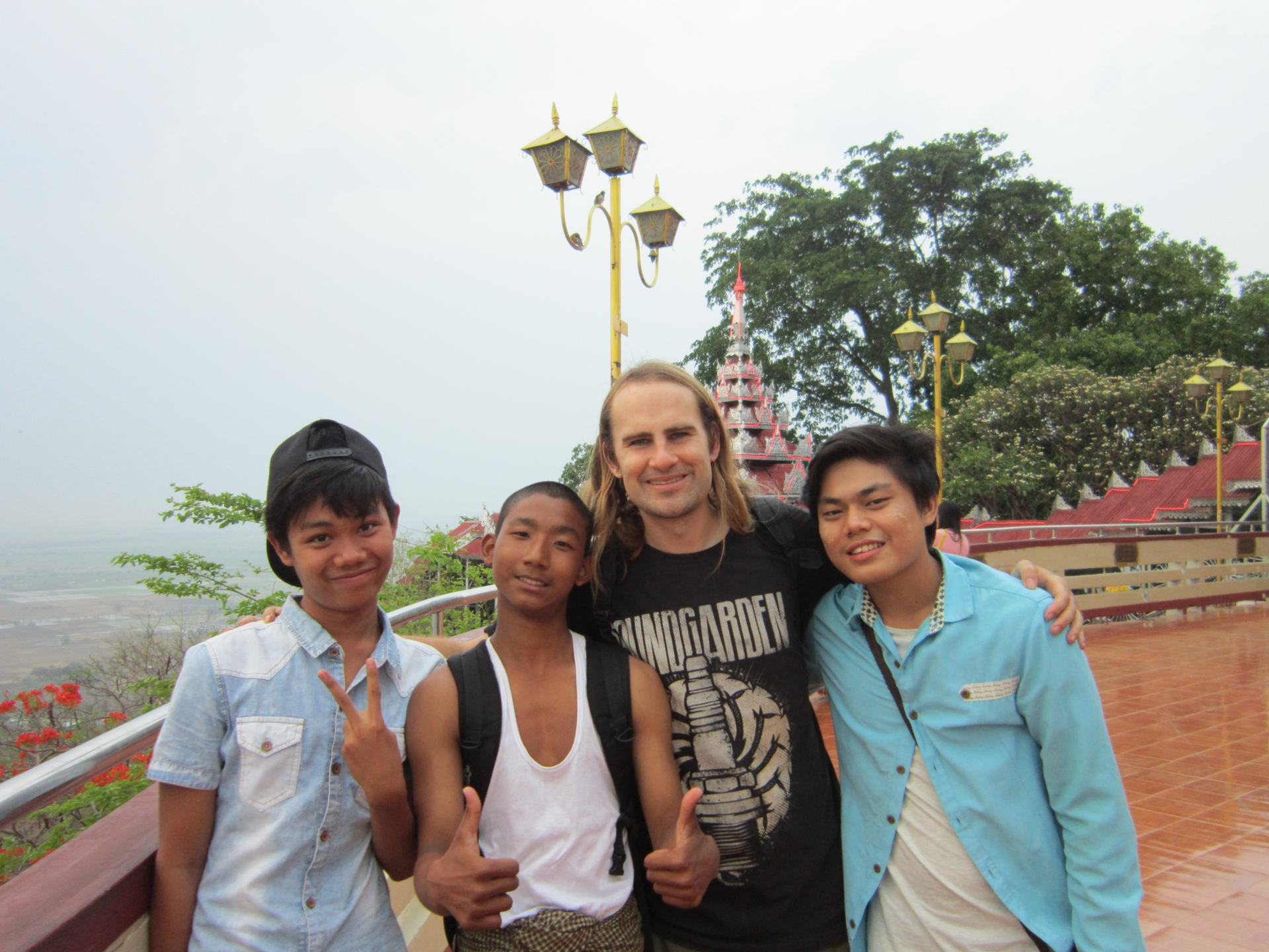 A photo of me with 3 local guys on Mandalay Hill.