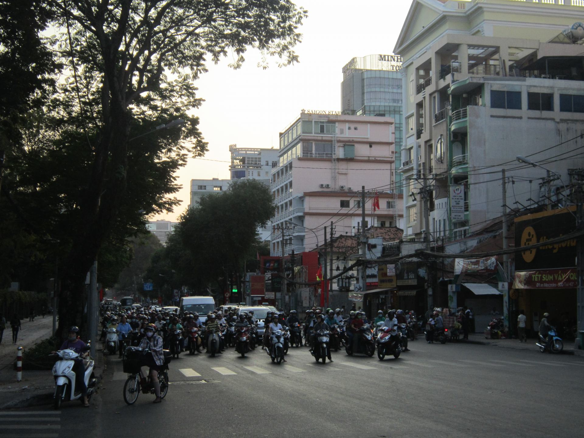 A road in Saigon, Vietnam full of motorbikes and cars