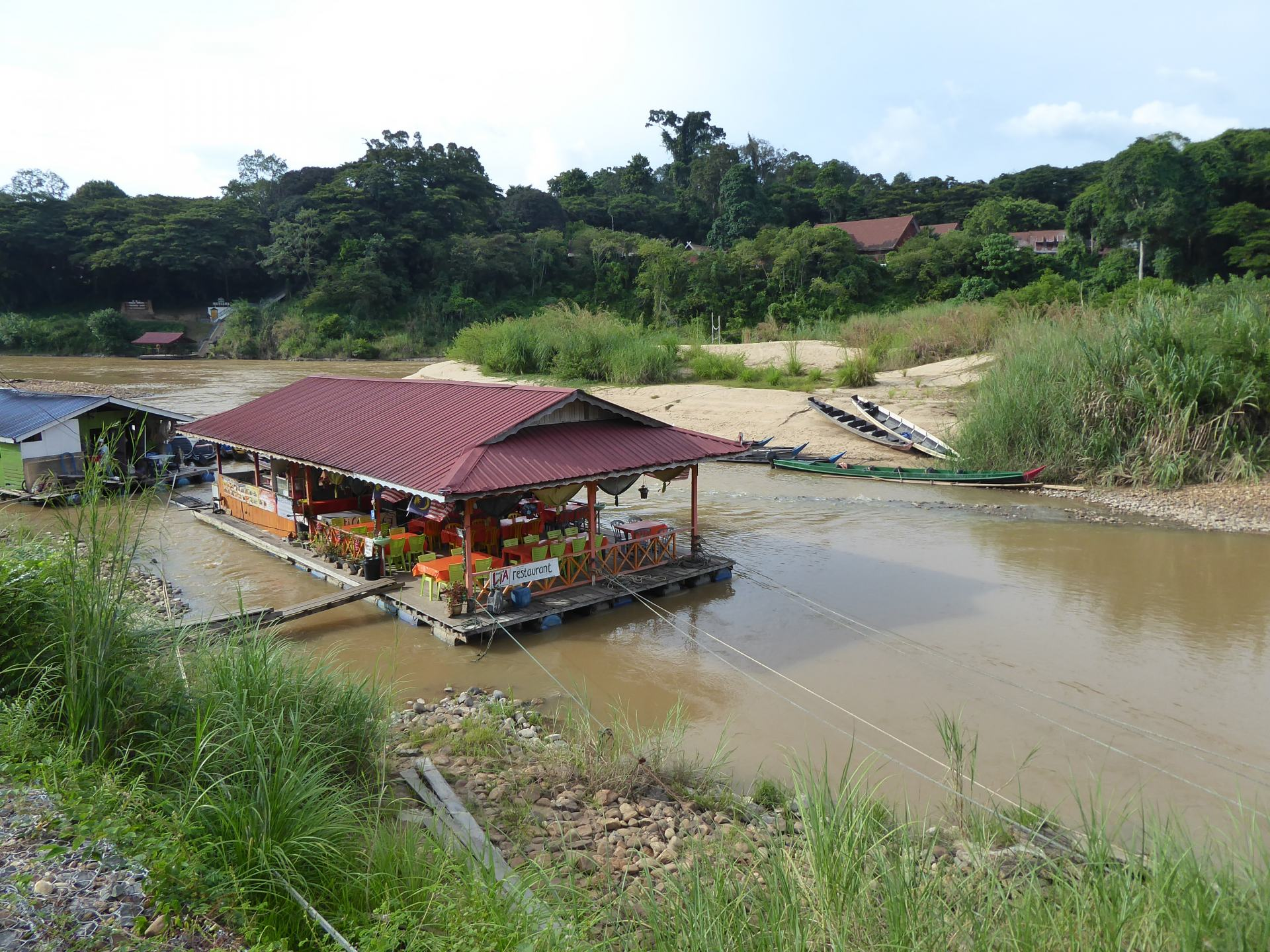 A view of a floating restaurant in Taman Negara, on the river with jungle around