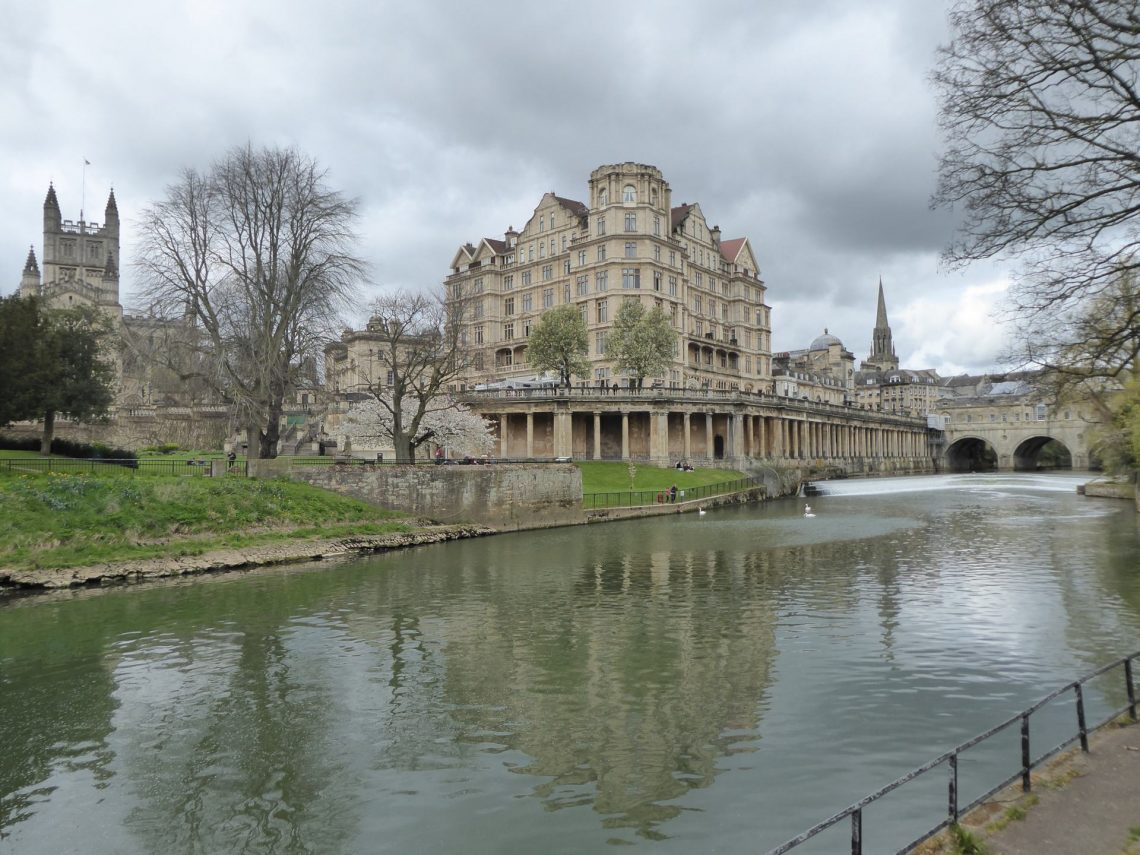 View across the River Avon of Bath Abbey, Empire Hotel and Pulteney Bridge